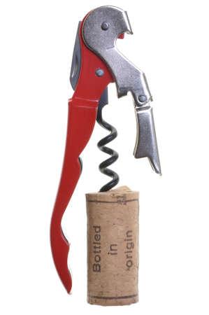 corcho: Sacacorchos con el corcho de una botella de vino