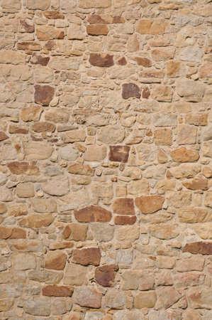 砂岩からの石の壁の背景