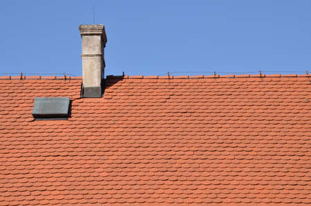 Traditional tile, red roof and blue sky Stock Photo - 14988865