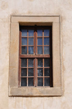 Window with steel bars on the wall of the castle photo