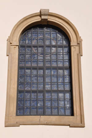 Arched window on the wall photo