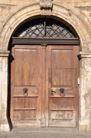 Old wooden door to the townhouse Stock Photo - 15890199
