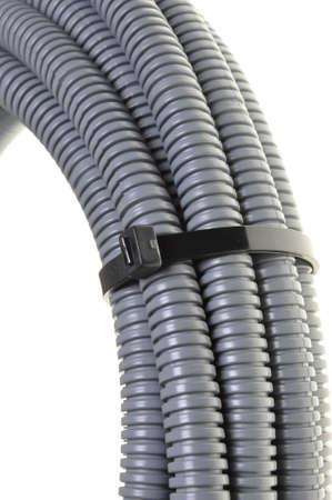 Gray plastic corrugated pipe isolated on white background photo