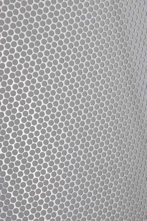 Metal sheet surface with holes photo
