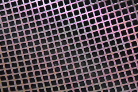 Metal surface with holes in the shape of squares Stock Photo - 16389380