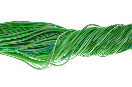 Bundles of green cables isolated on white background photo