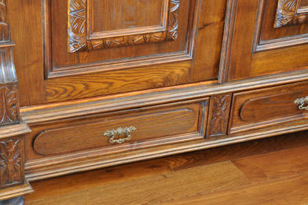 Old antique wardrobe with drawers on the wooden floor photo