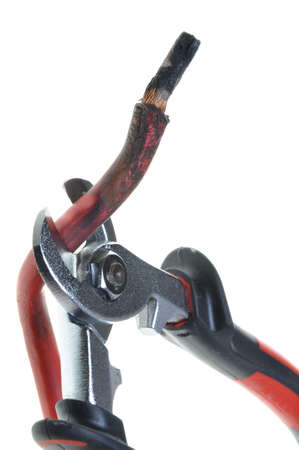 disconnecting: Nippers is cutting damaged red cable