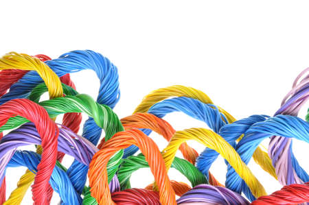 Multicolored computer cable bundles isolated on white background photo