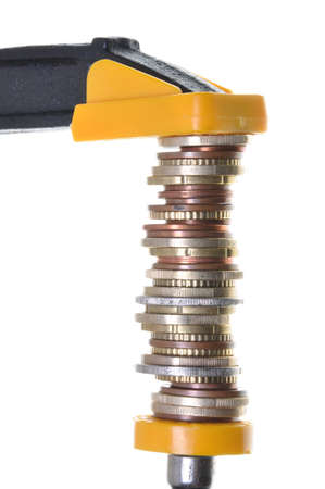 Savings in crisis, coins in a steel clamp Stock Photo - 18332981