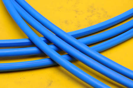 Blue cable lines on on yellow wall Stock Photo - 18588602