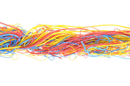 Tangled cables in telecommunication networks isolated on white background photo
