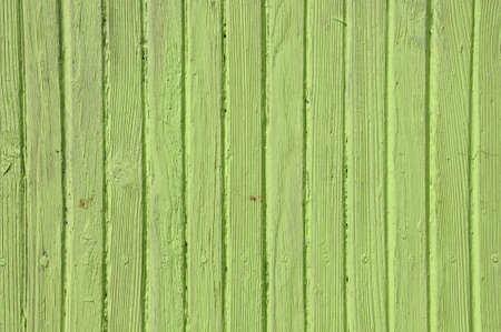 Wooden old fence, green background