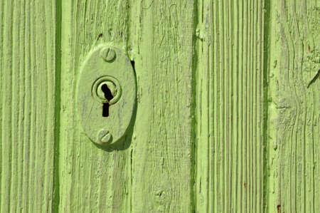 Wooden green door with lock  photo