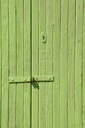 Wooden green door with lock  Stock Photo - 19120647