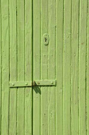 Wooden green door with lock Stock Photo - 19120647
