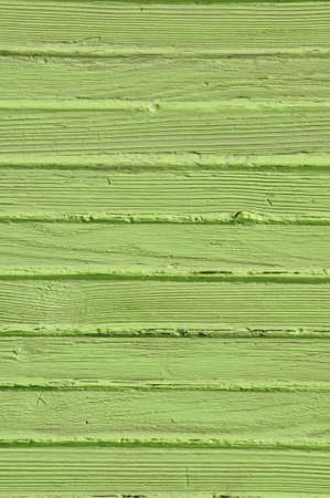 Wooden old fence, green background  photo