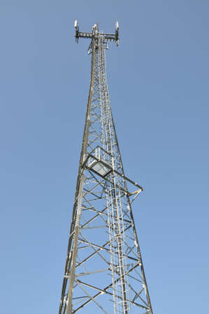 Telecommunication cell phone tower against blue sky  photo