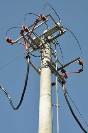 isolator insulator: Electric pole with transformer against the sky