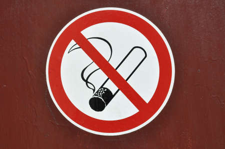 No smoking sign on red wall  photo