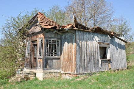 damaged roof: Old ruined abandoned wooden house