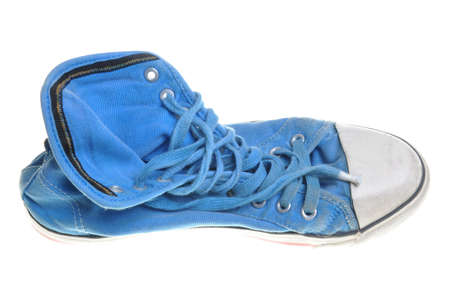 Old blue sneaker isolated on white background  photo