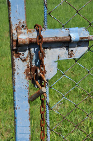 Old blue barrier with lock and chain  photo