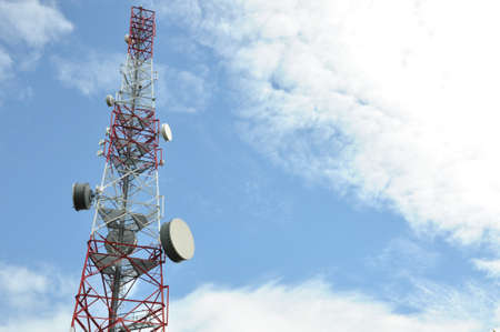 Tower with cell phone antenna system against photo
