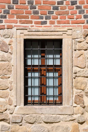 Barred window in a red brick wall Stock Photo - 20780354