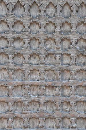 Wooden door in church Sant Anastasia in Verona, northern Italy  photo