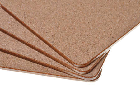 Cork mat with brown border isolated on white background  photo