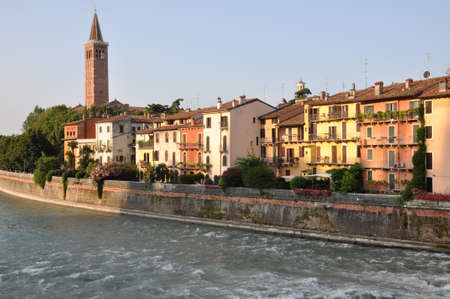 Colored houses of Verona on the river Adige, Italy  photo