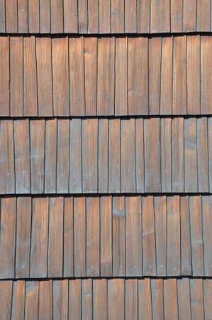 Wooden shingles surface, traditional roofing photo