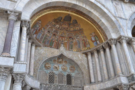 marco: Portal with gold mosaic in San Marco Basilica Venice, Italy  Stock Photo