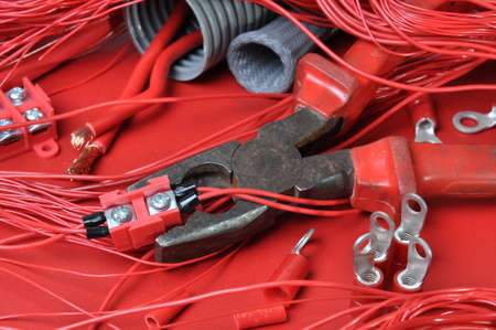 Electrical components and tools in the current colors of red-hot  photo