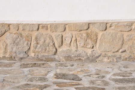pedestrian walkway: Pedestrian walkway in front of old stone wall  Stock Photo