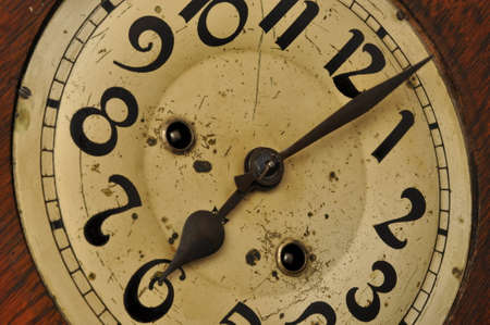 Detail of clock face with numbers and hands photo