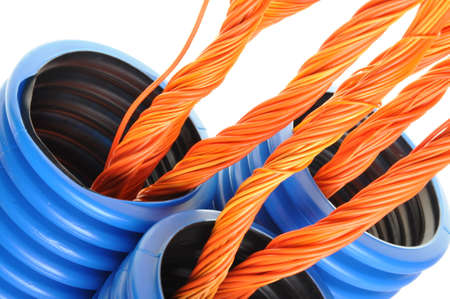 Blue corrugated pipe with orange cables isolated on white  photo