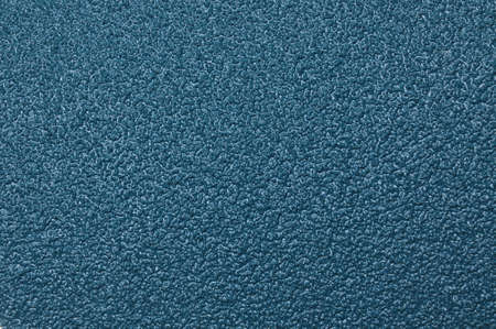 Surface of blue sandpaper  photo