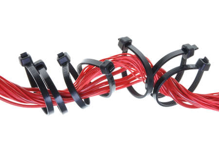 Red electric cable with cable ties isolated on white background