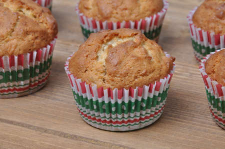 Muffins on wooden board in the kitchen  photo