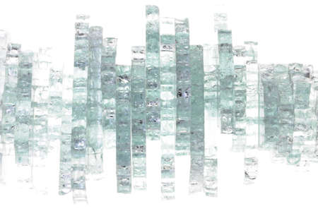 Pieces of broken glass on white background  photo