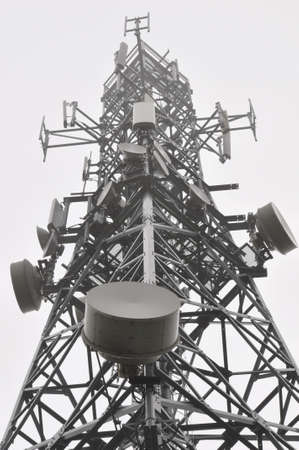 Telecommunication tower with antennas in the mist photo