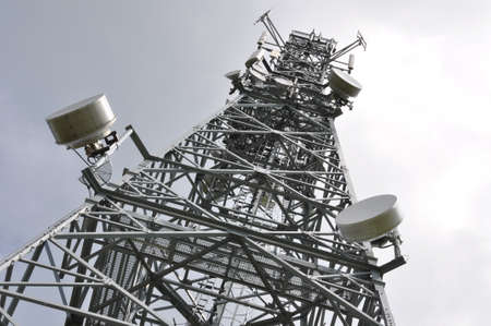 Telecommunication tower with cell phone antennas photo
