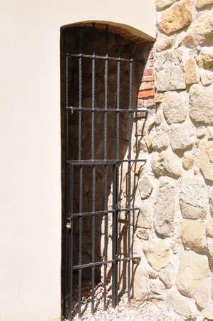 Old rusty lattice door in the castle  photo