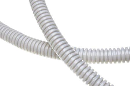 Plastic corrugated pipe isolated on white background  photo