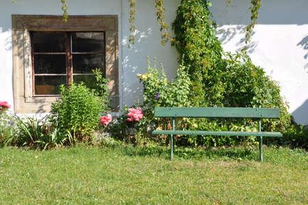 Wooden bench in the garden photo