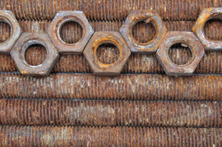 corrode: Rusted long bolts and nuts