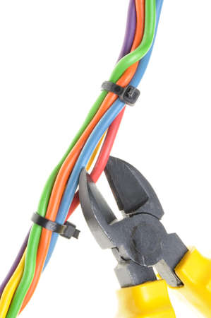 disconnecting: Metal nippers and bundle of electrical cables