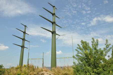 High voltage electric towers against blue sky  photo